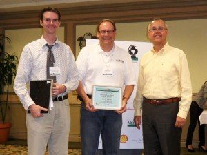 Christopher Wilson, Brad Rawlins (Brigham Young University) accept IPRRC Top Paper Award