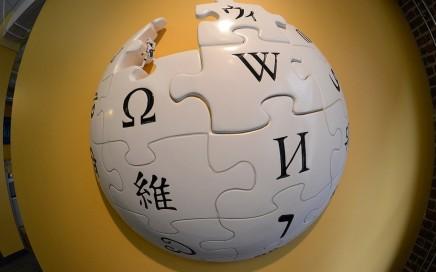 Wikipedia Logo on Yellow Wall